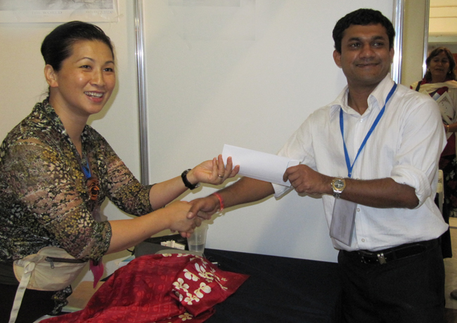Yvonne Chung, WONCA Administrative Manager  - well known to many colleagues for her calm and efficient assistance always given willingly and a with a smile - seen here with Dr Naidu of Fiji
