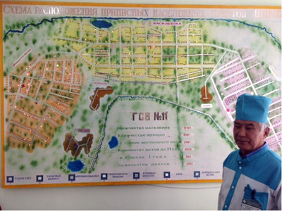 Dr Bazarkul Duishenaliev with his map for monitoring chronic disease in each of the villages of his rural region
