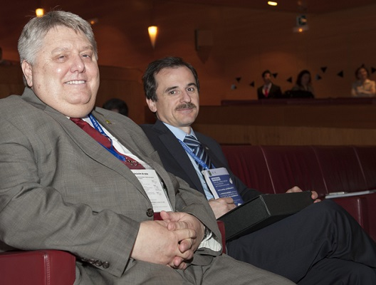 Rich Roberts and José Miguel Bueno at closing ceremony in 2012 - they seem relaxed at the end of the conference.